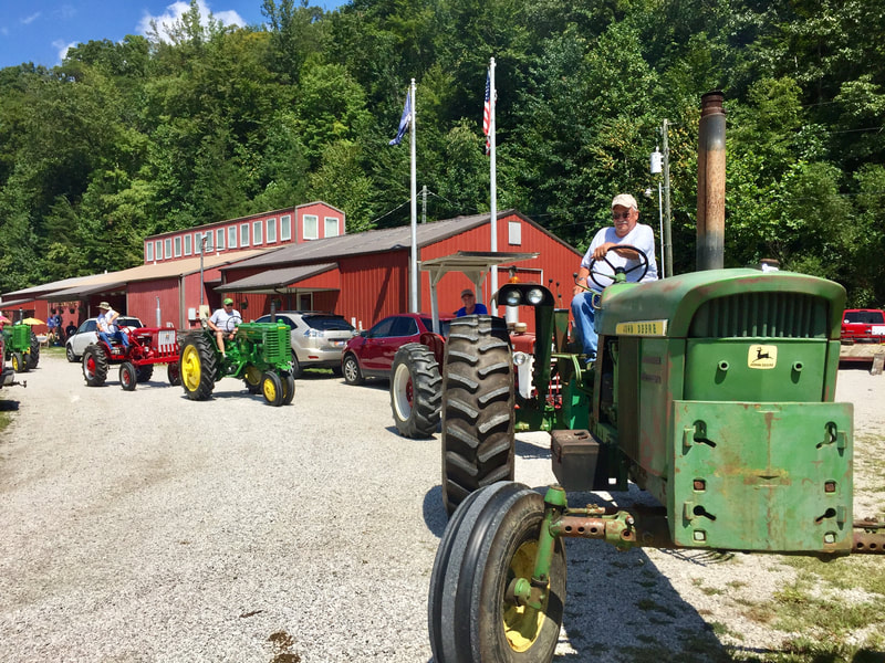 Tractors and their drivers lined up for the tractor parade.